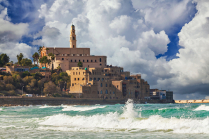 Old town of Jaffa over the sand beach bay on sunset, Tel Aviv, Israel